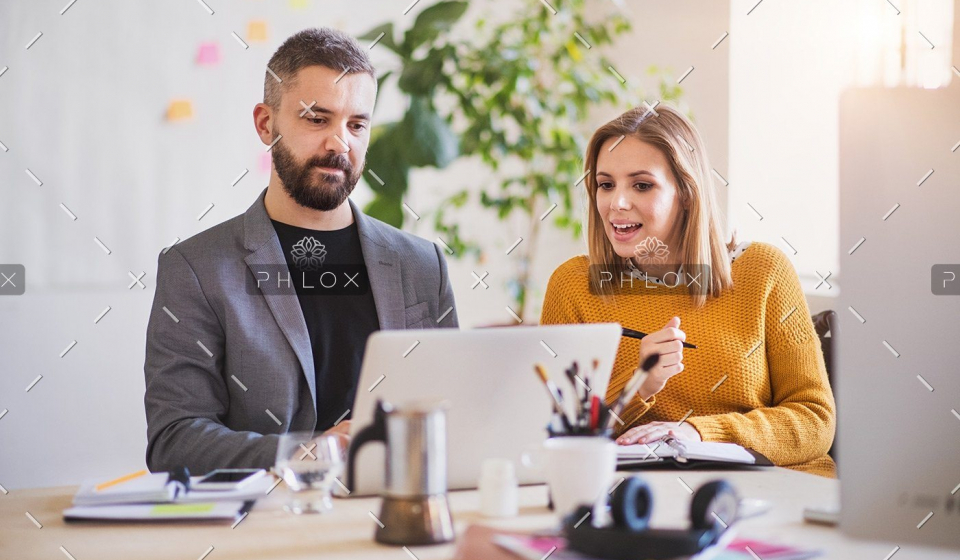demo-attachment-172-two-business-people-with-wheelchair-in-the-office-P7XLSBC